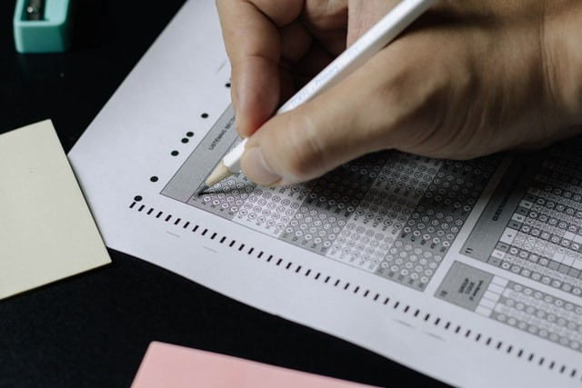 A person bubbles in answers on a standardized test.