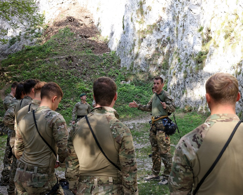 Yankee Company, 45 Commando conducting a brief from Slovenian Mountain Leaders before training Vertical Assault and abseiling techniques