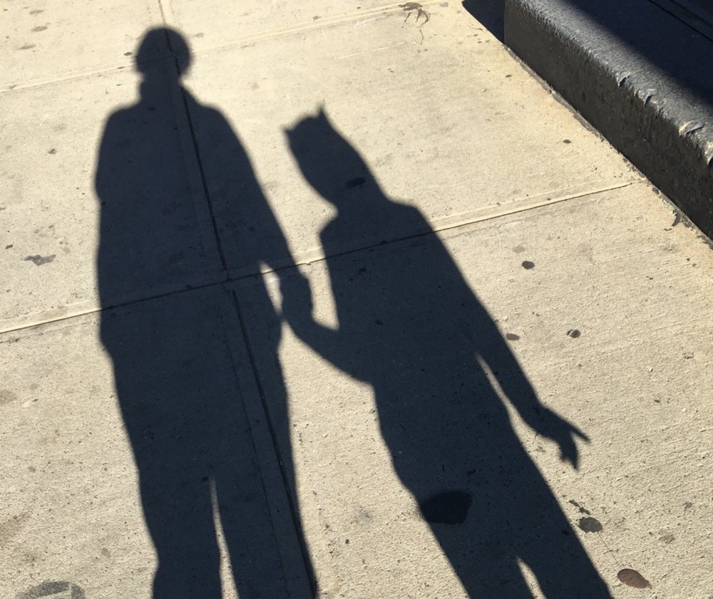 Mother and daughter in shadow