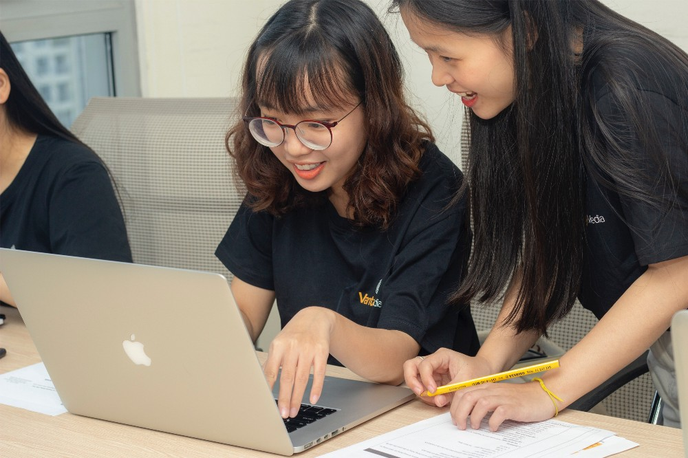 Students using a laptop.