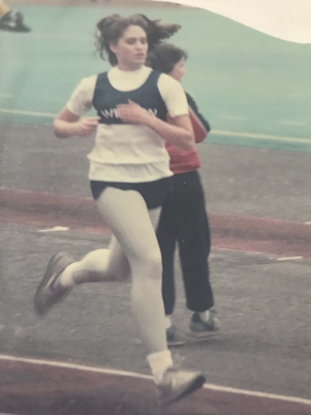 The author, running on a the track, competing in a race back in her younger days.