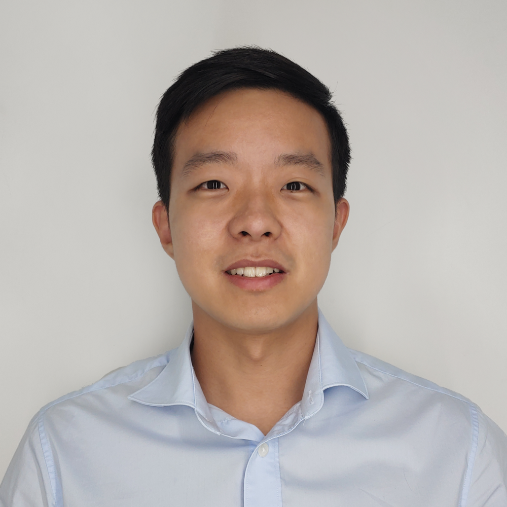 Heemin Yang in front of a white background.