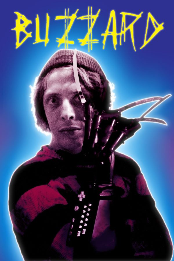 A man with a Freddy Krueger glove looks at the camera.