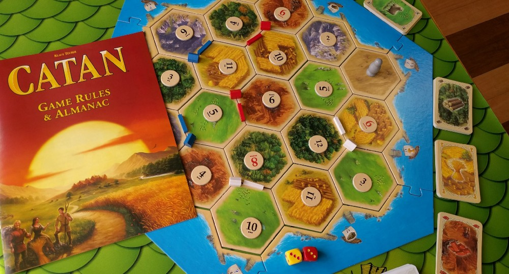 Settlers of Catan is a board game that teach beginners about investing