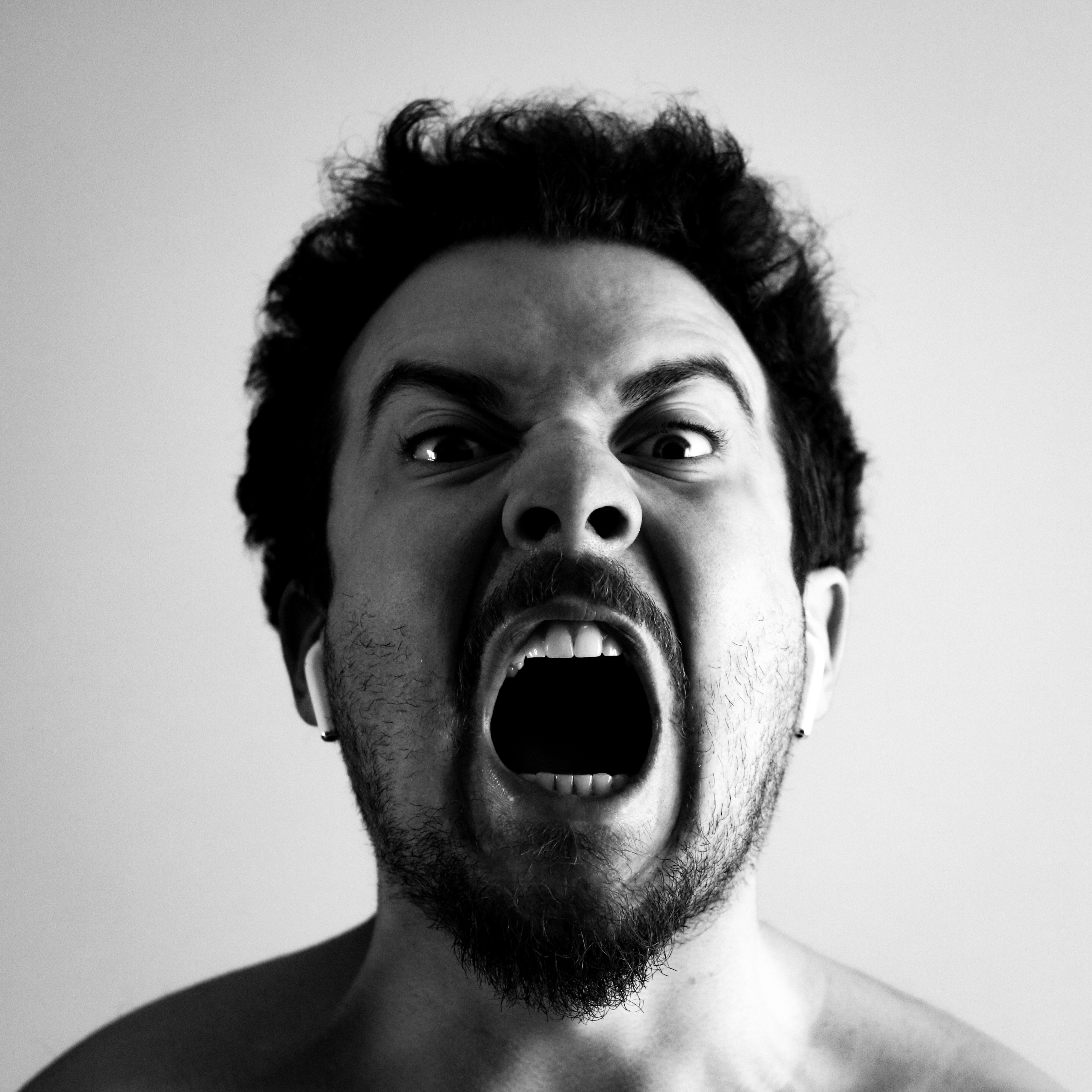 A man screaming in rage