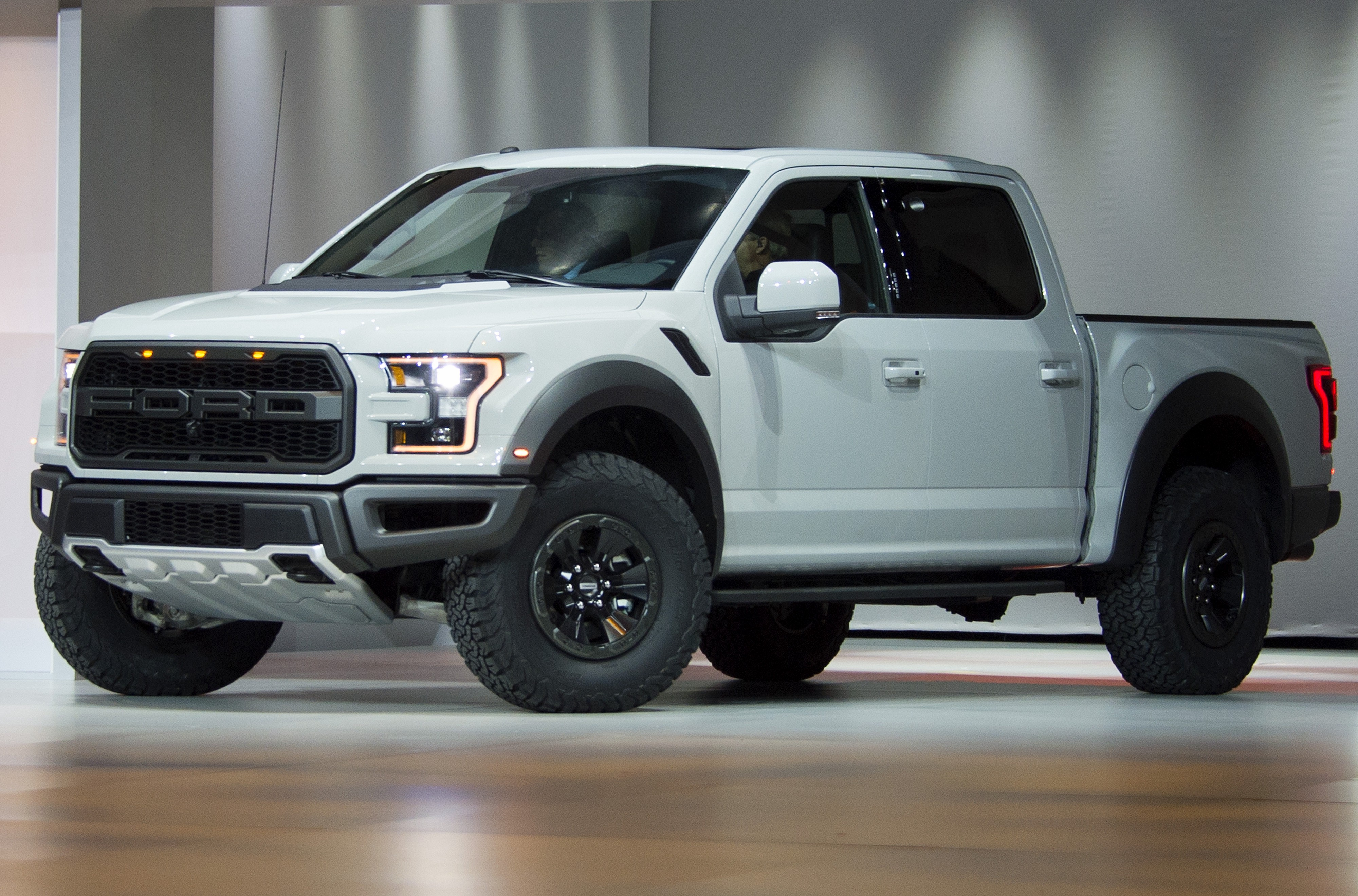 A white Ford F-150 Raptor is unveiled during the Ford press conference at the North American International Auto Show in 2016.
