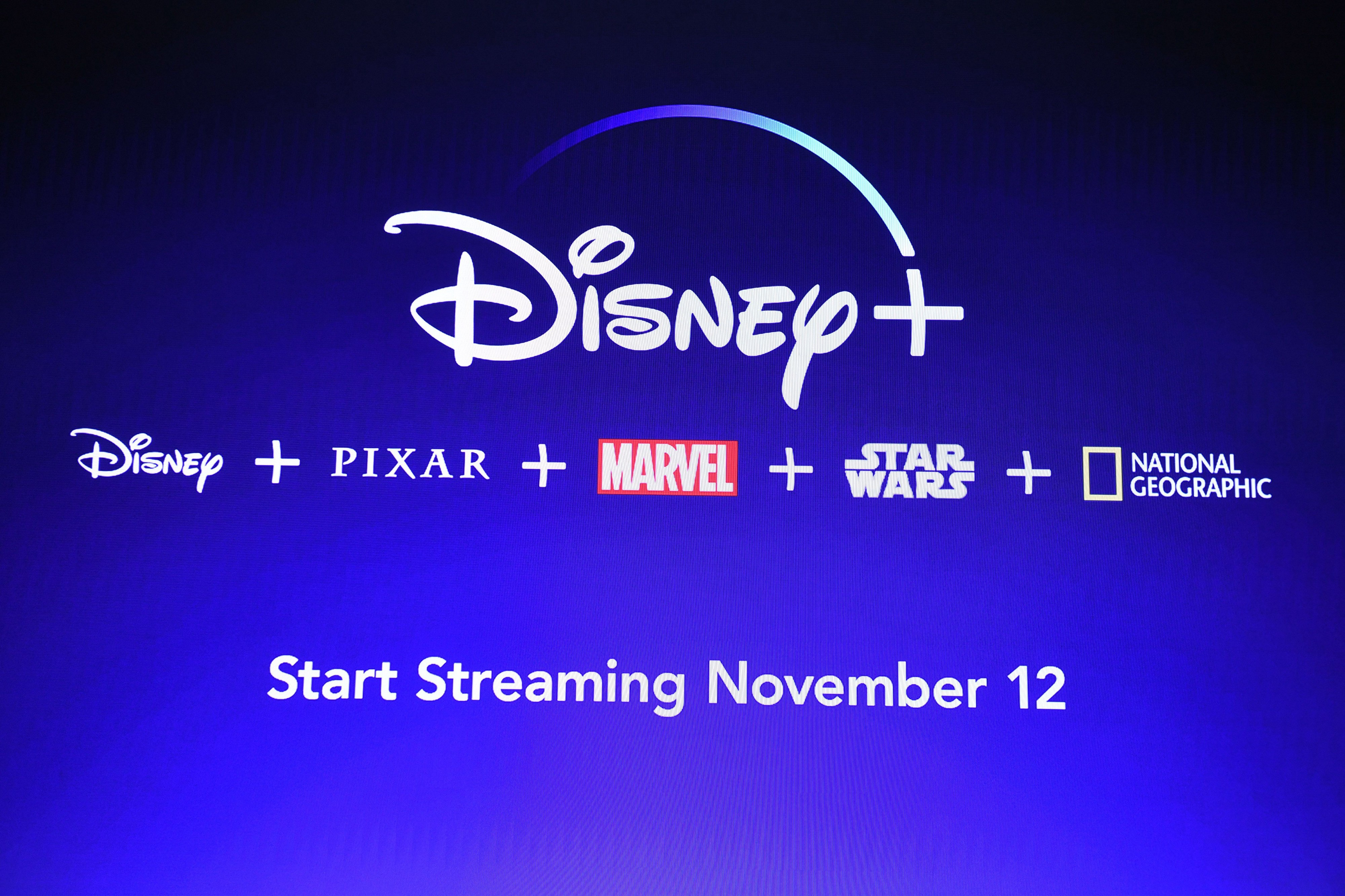 A screen announcing the Disney+ streaming service is seen at the D23 Expo.
