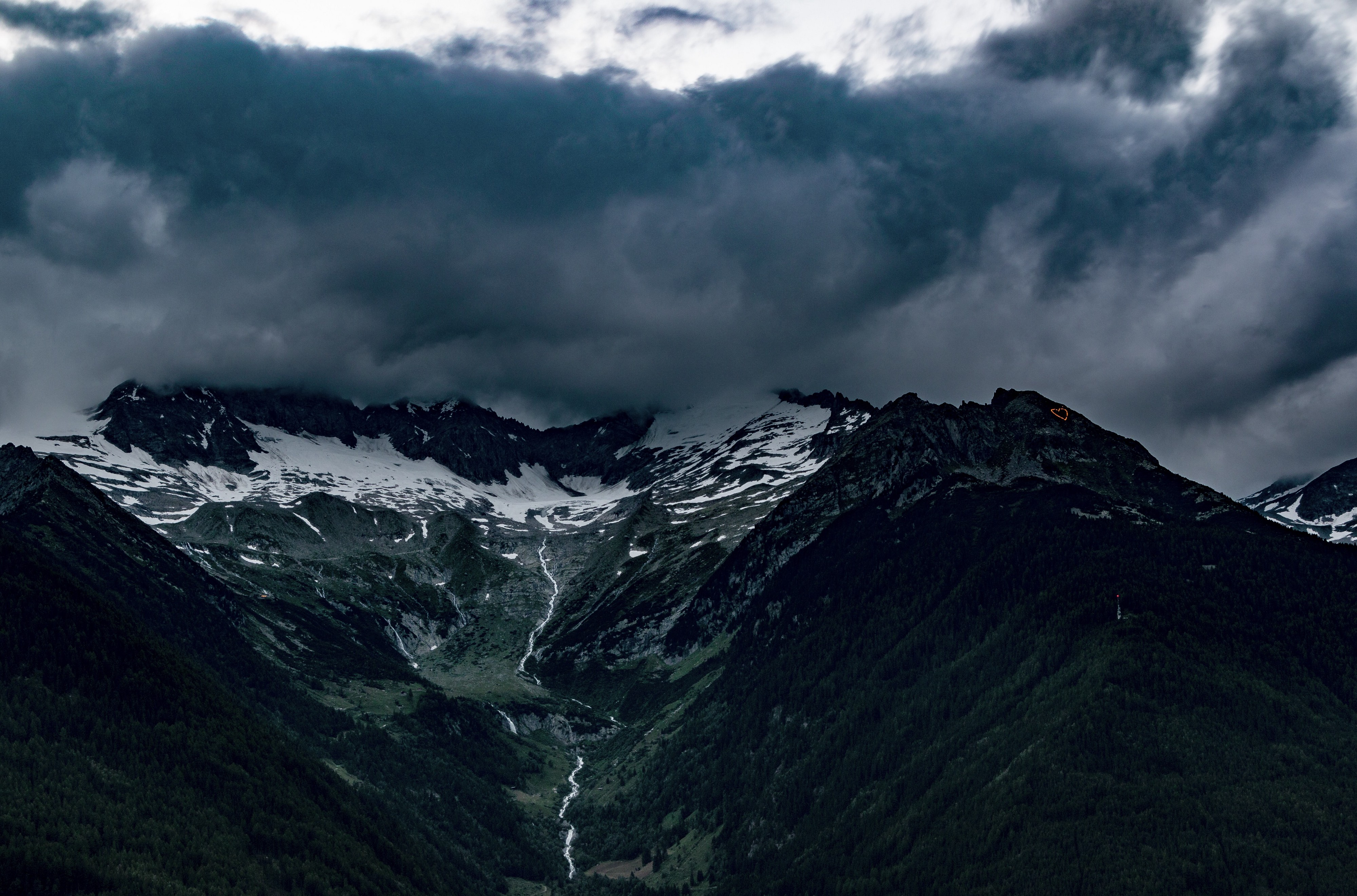 Mountain range covered by storm clouds