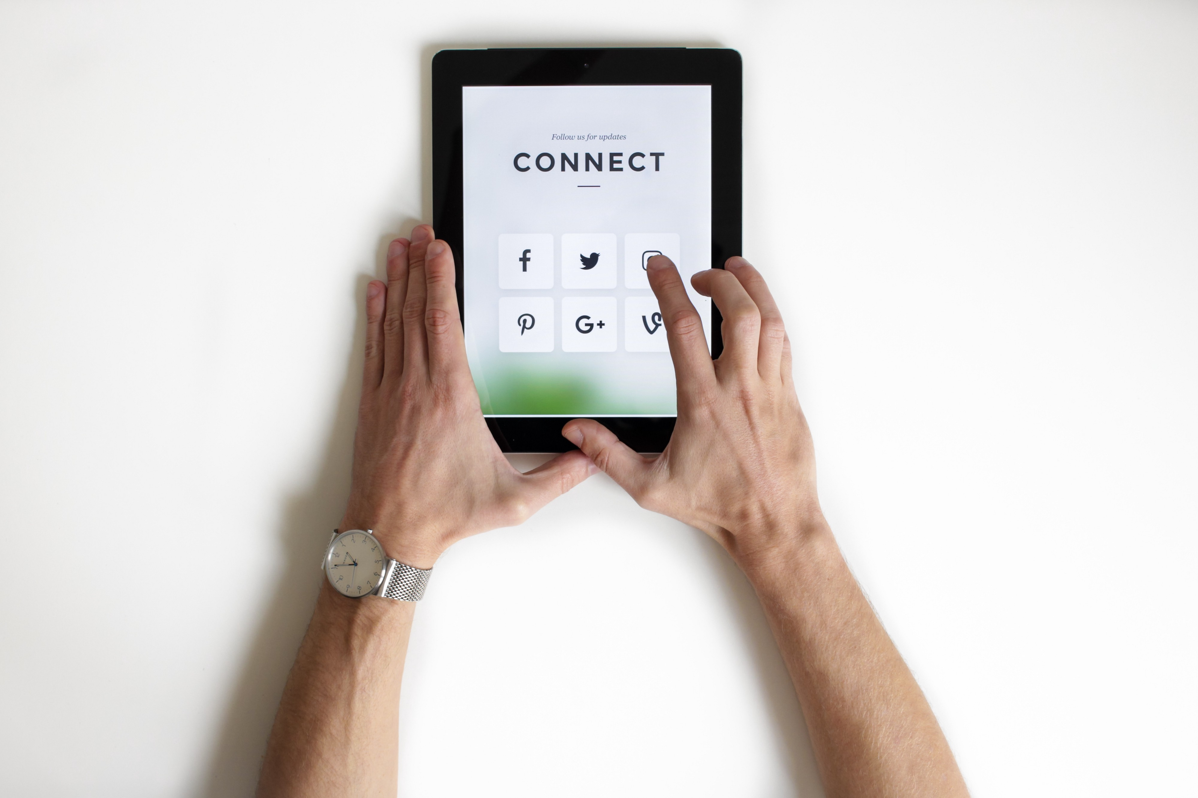 connecting on social media with a tablet