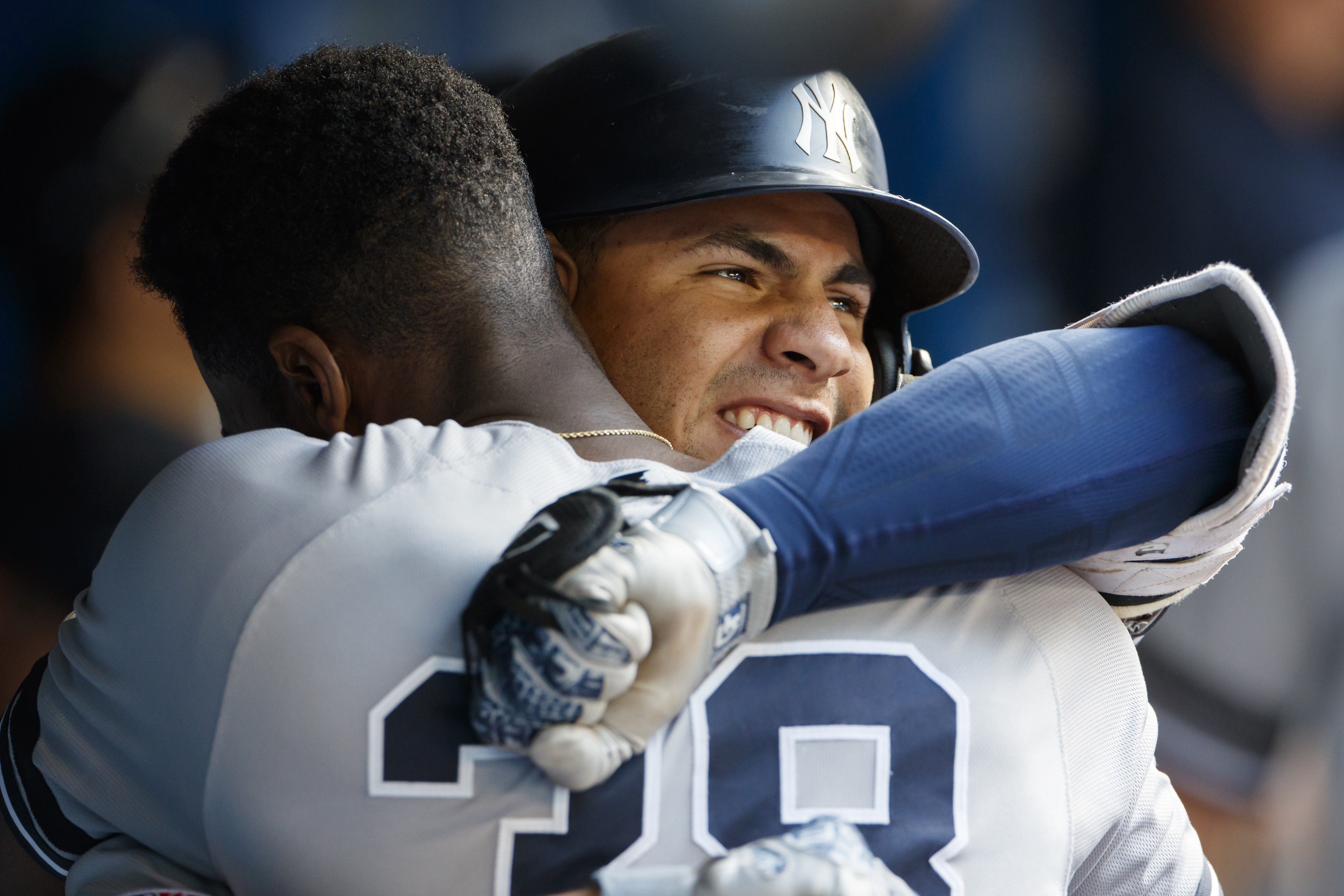 NY Yankees teammates Gleyber Torres and Cameron Maybin hug as they celebrate a two run home run against the Toronto Blue Jays