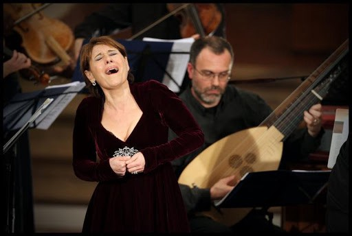 Woman singing at an opera.