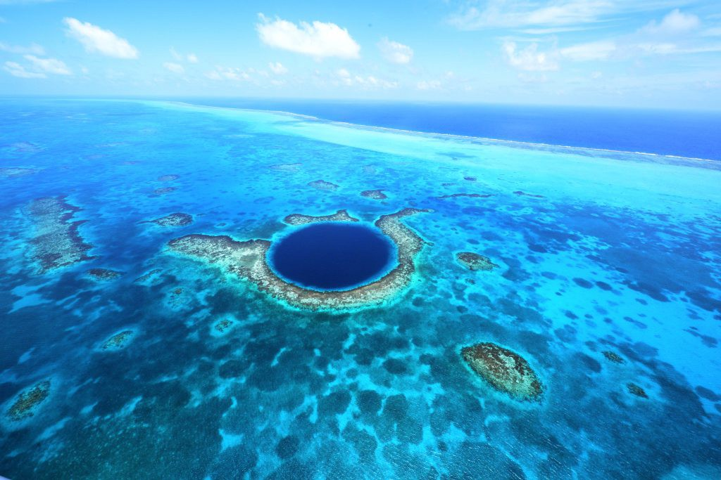 Depths of Belize's Great Blue Hole, the World's Largest Sinkhole, Explored by Submarine | by Belize Hub | Medium