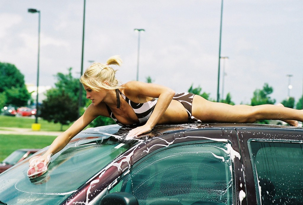 Car wash young sexy woman blue stock photo