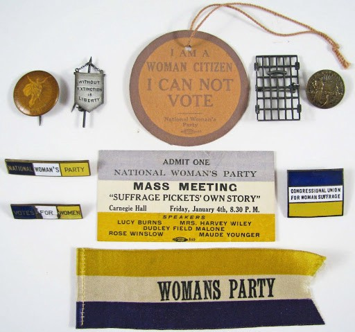 National Woman's Party memorabilia: ribbons, pins, event ticket for mass meeting