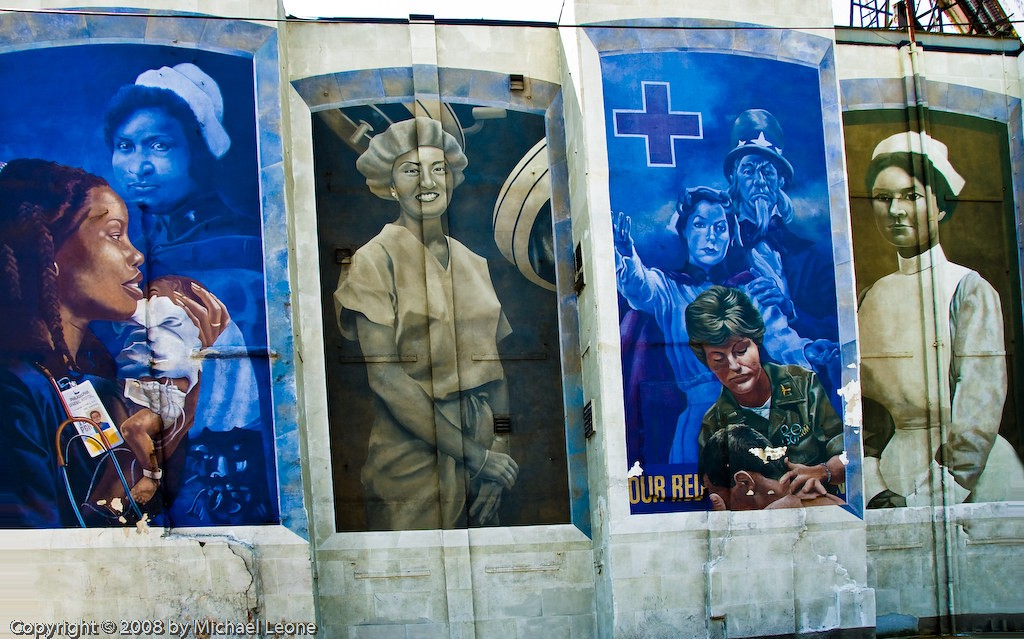 Artwork on a wall showing healthcare workers with war imagery