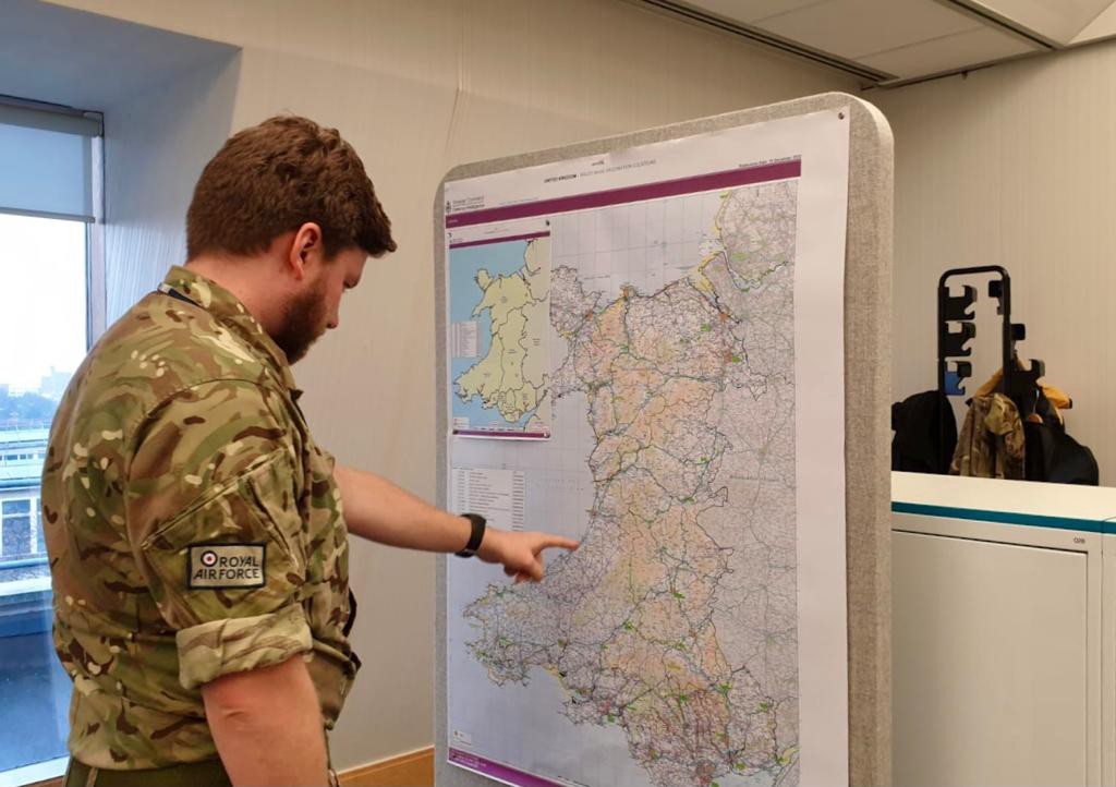 A Royal Air Force planner looks at a map of Wales