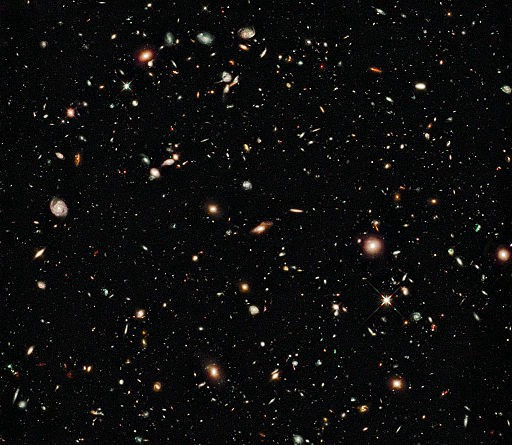 A picture from the Hubble Telescope showing tens of thousands of galaxies.