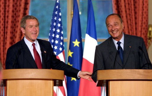 A friendly image on a podium with President Bush and President Chirac