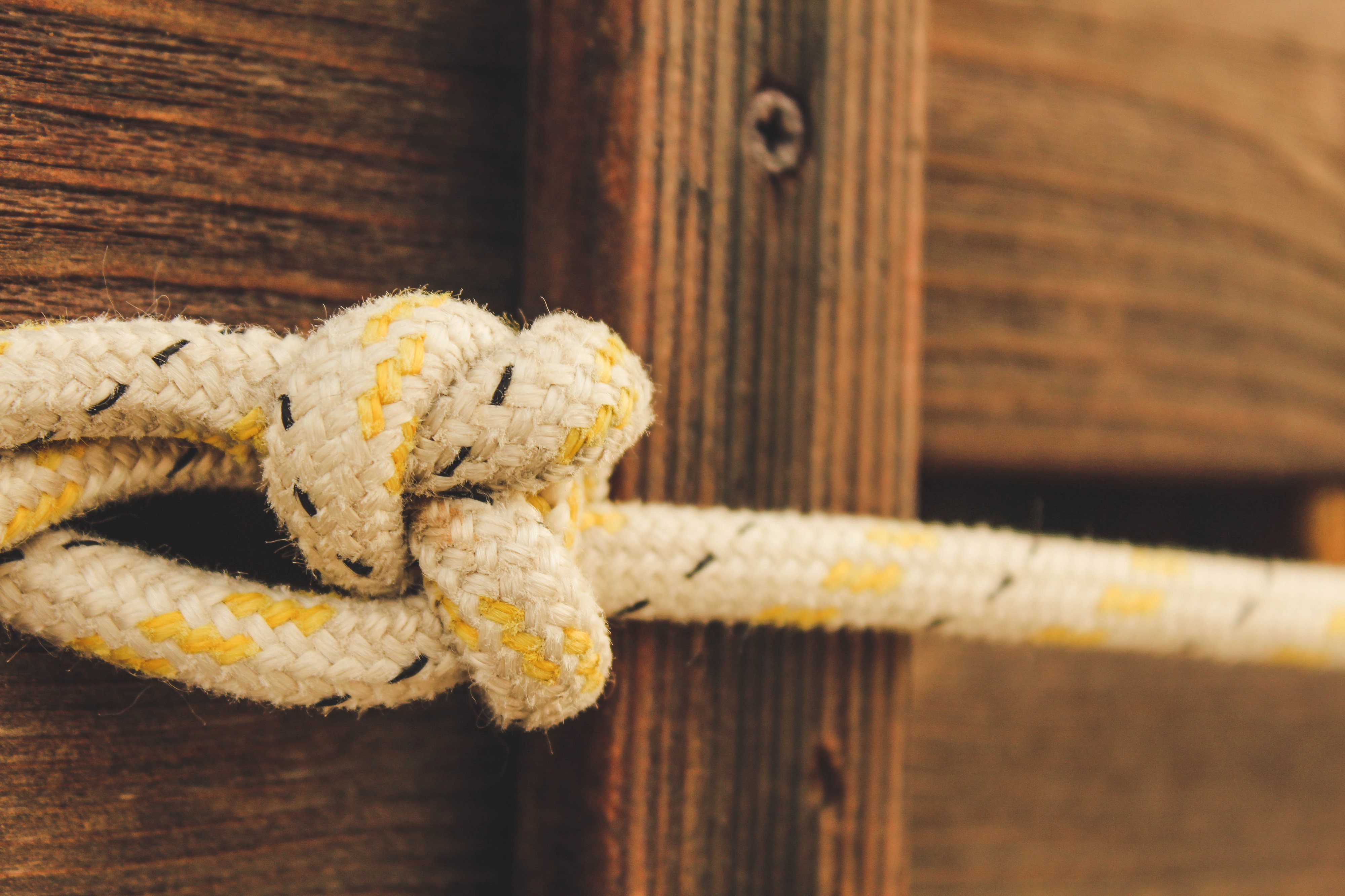 A macro shot of a rope tied into a knot.
