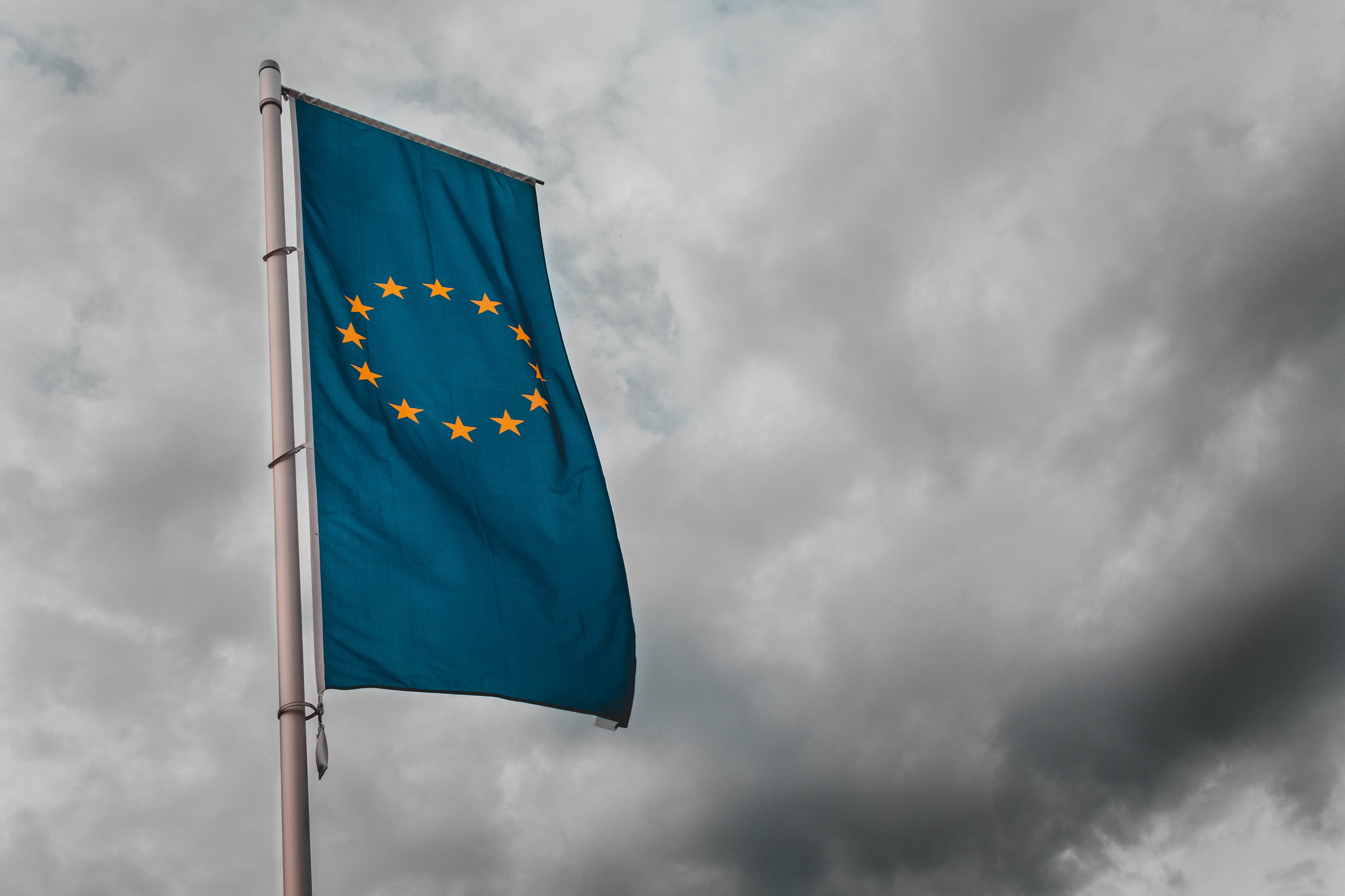 European Union flag hanging from a pole