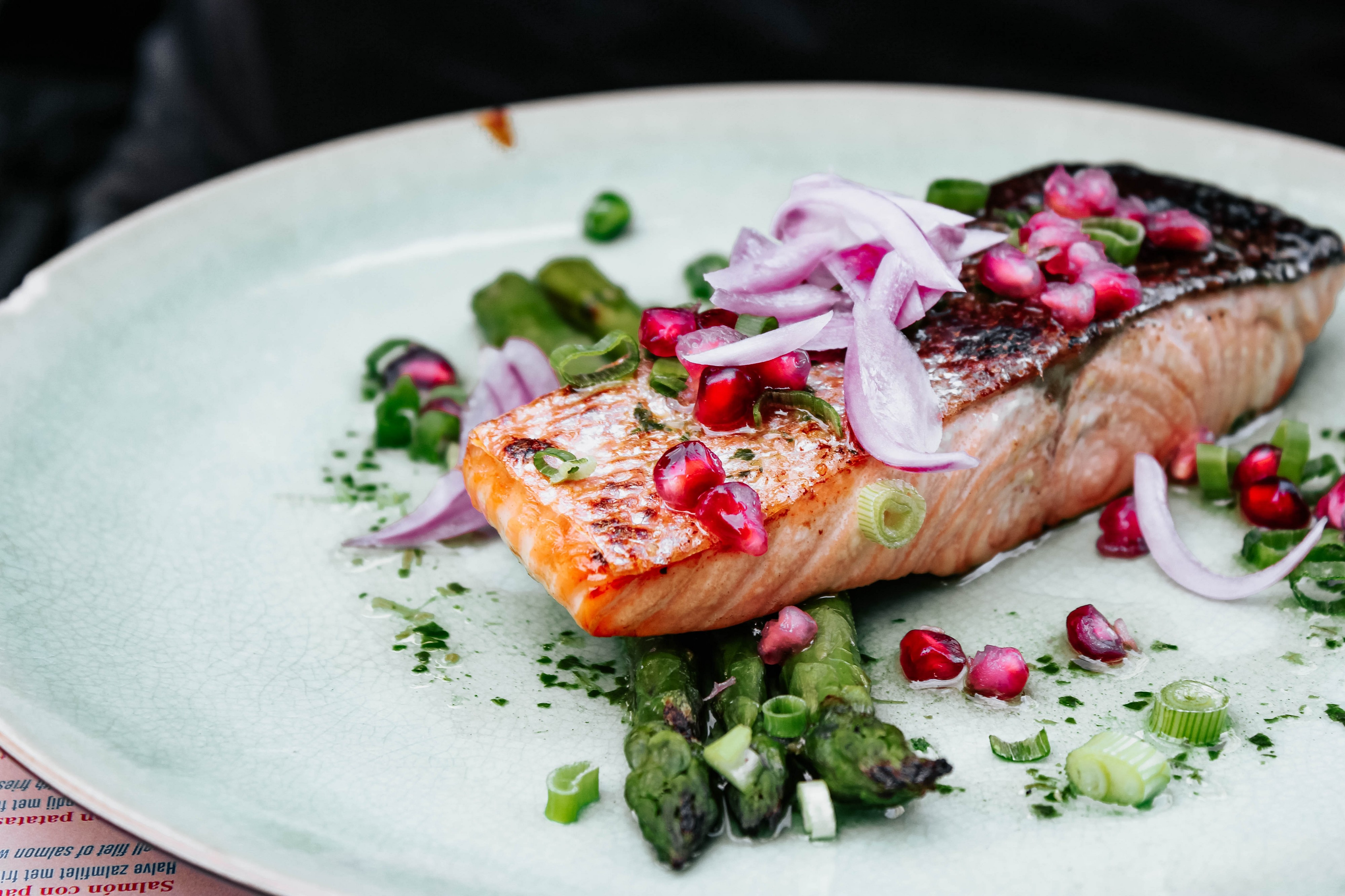 Tasty salmon with onions and vegetables