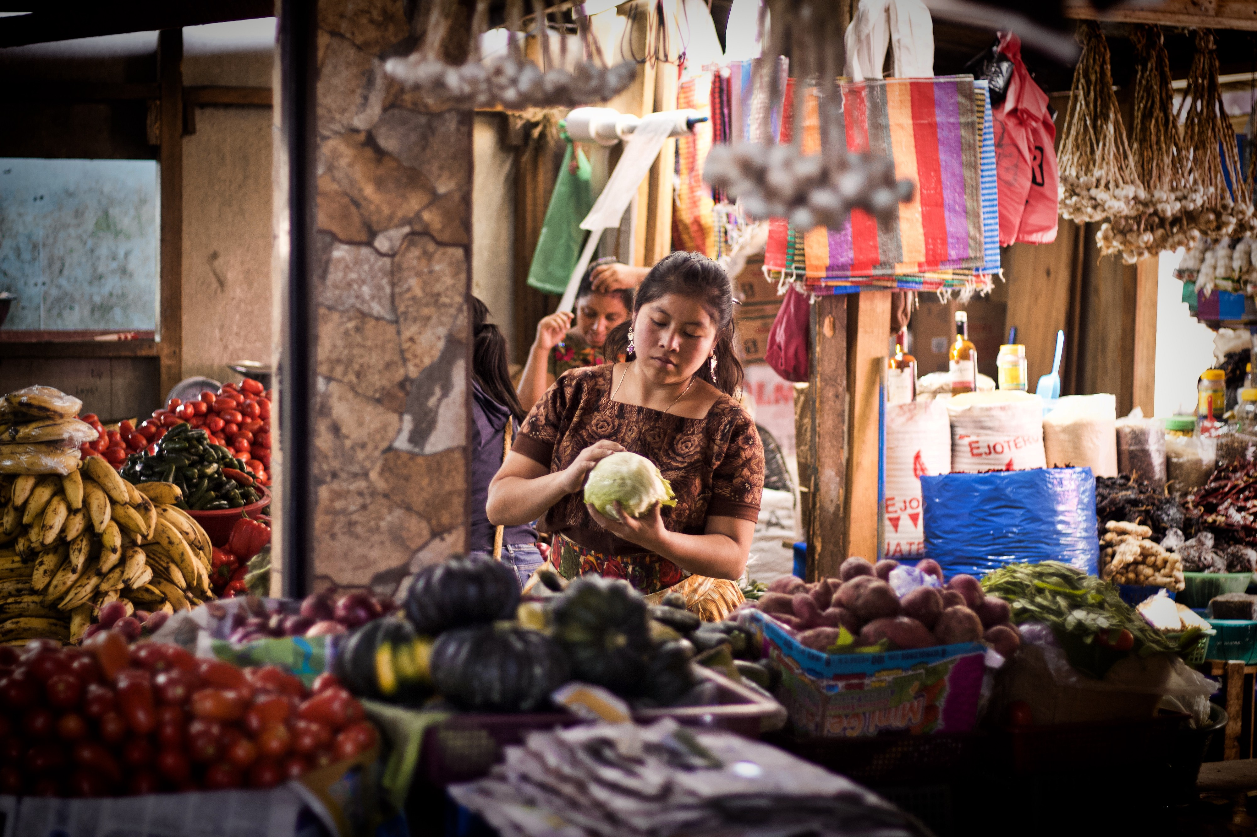A woman selling fruit in the market, Guatemala