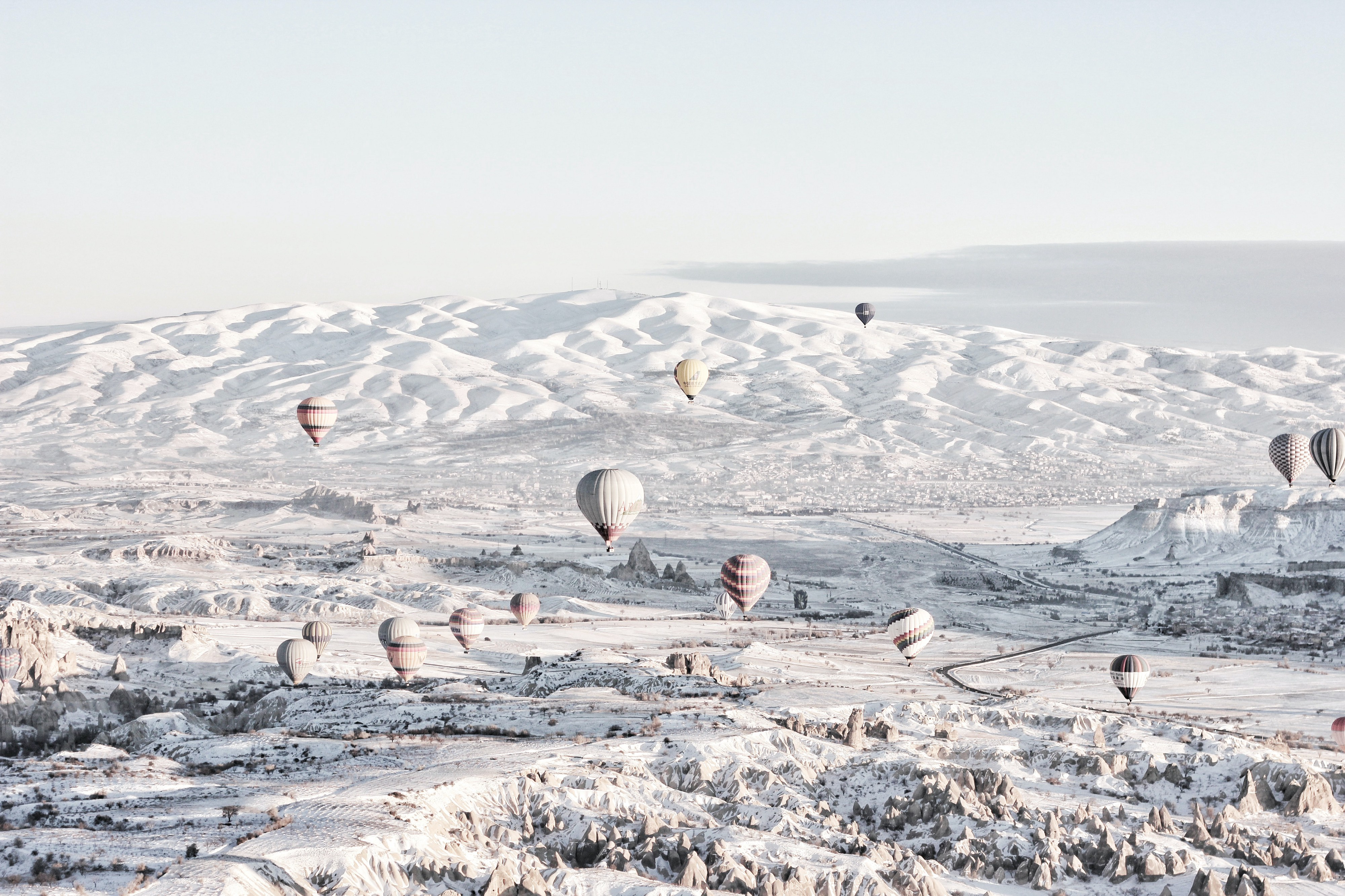 Hot air balloons in a snowy landscape