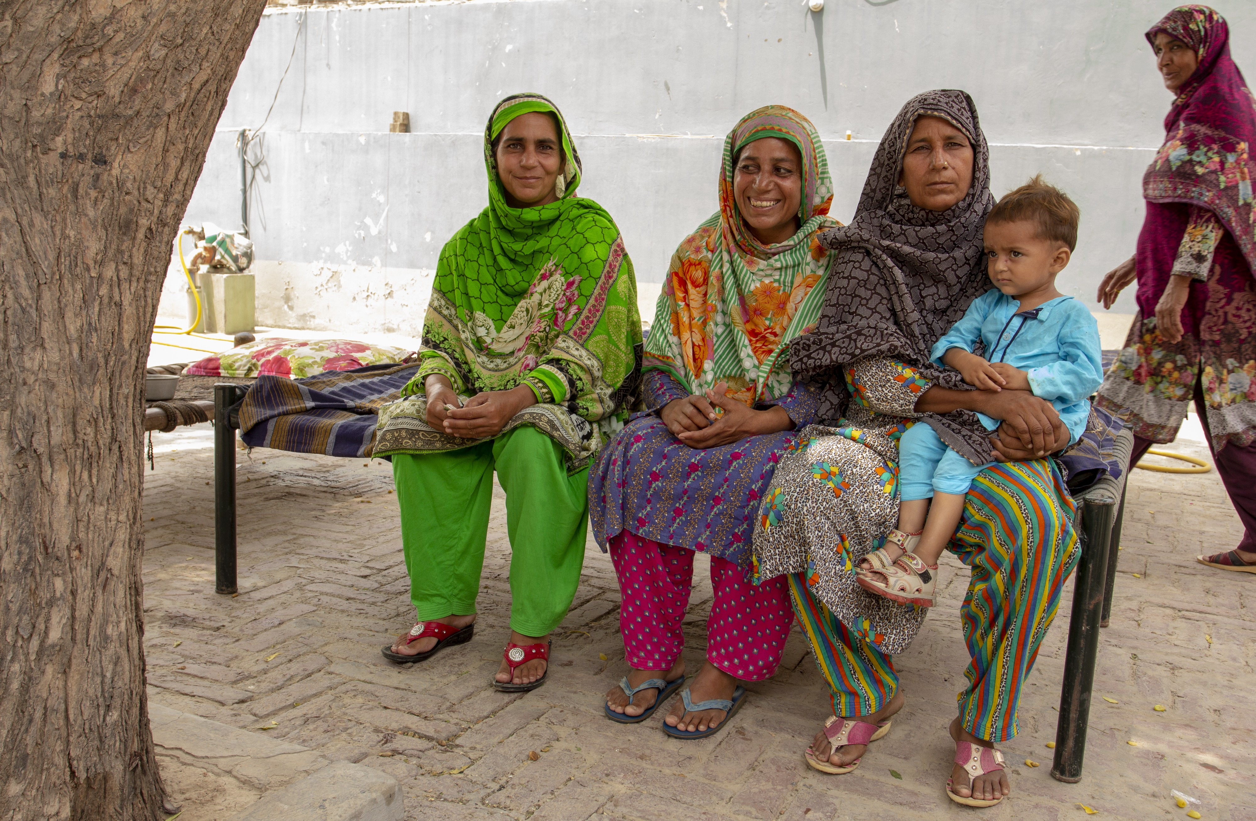 Parveen Akhtar (left) and her two sisters benefited from a new insurance program. Photo: Flore de Preneuf/ World Bank