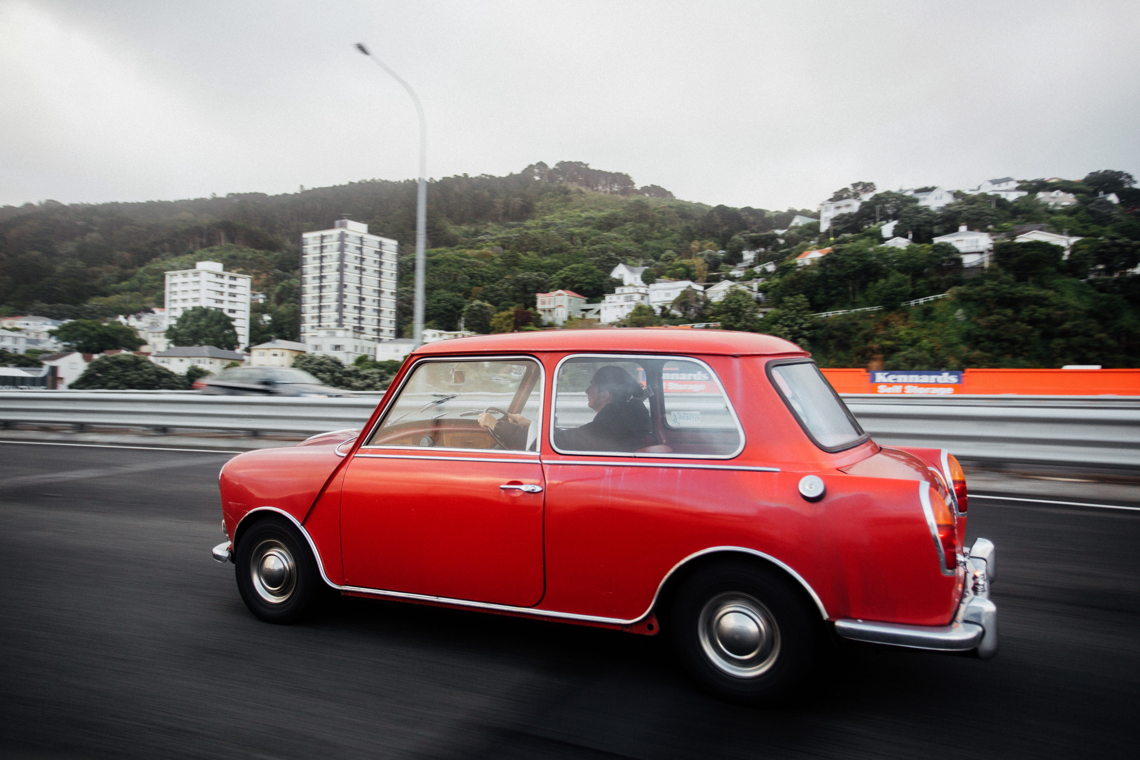 small red car being on a highway