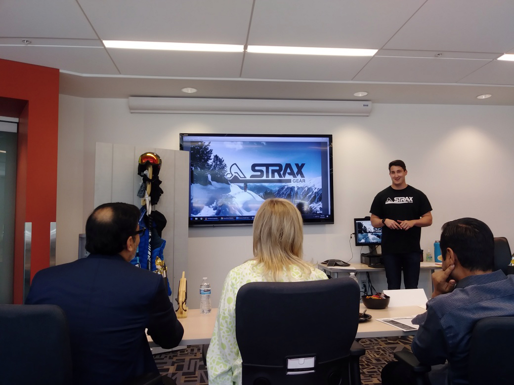 Strax Gear presents their company with a presentation and examples of their products to three judges.