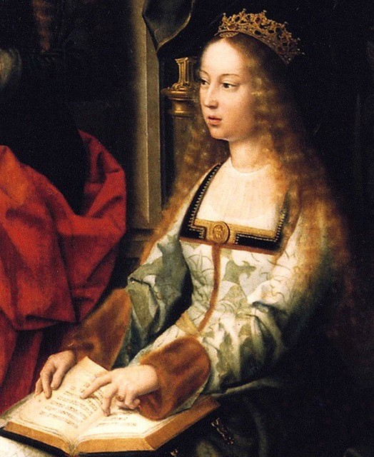 A young Isabella I on her throne. Here long red blonde hair is down and falling around her shoulders. She is wearing a green and white square neck dress with a white floral pattern