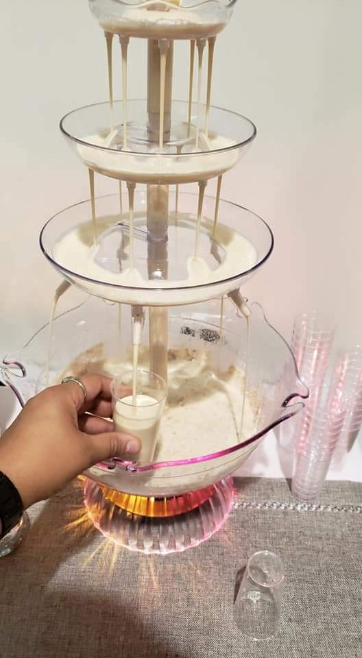 coquito coconut rum drinking fountain holiday christmas