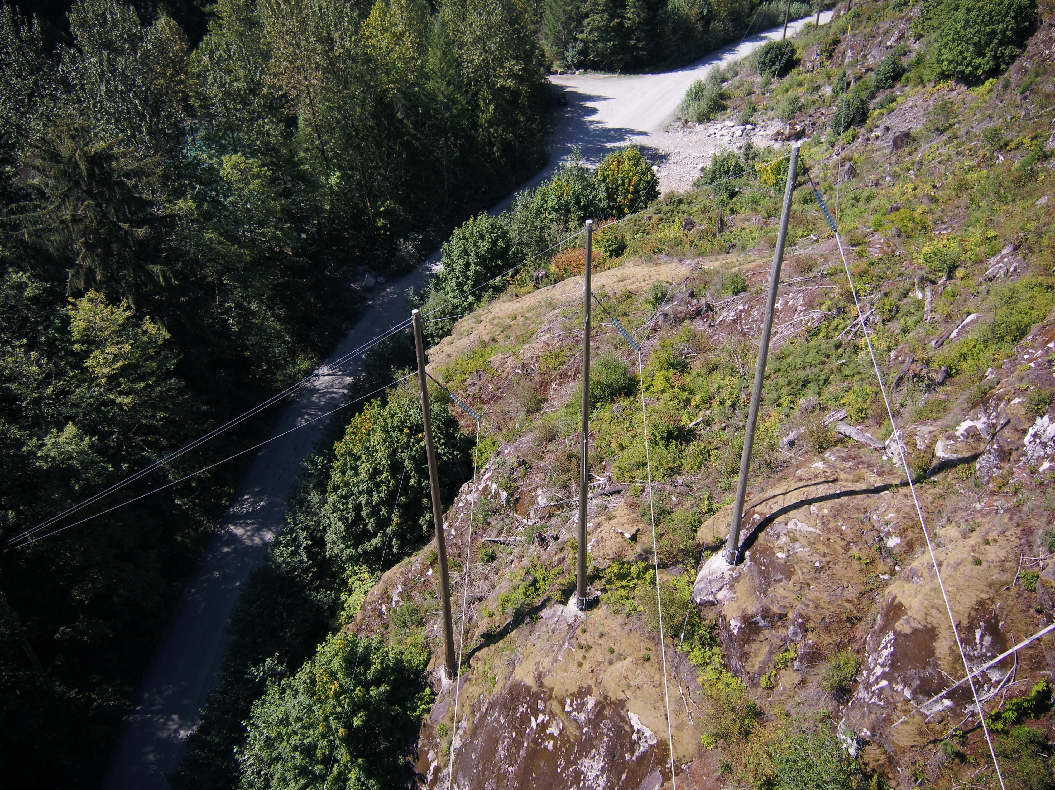 Powerlines along rugged cliff