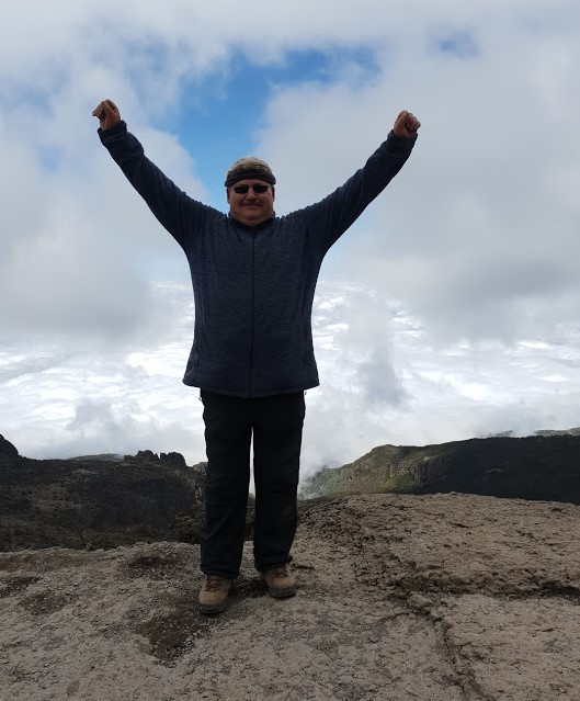 Image By Sean McBride Standing above the clouds on top of the Barranco Wall on Kilimanjaro