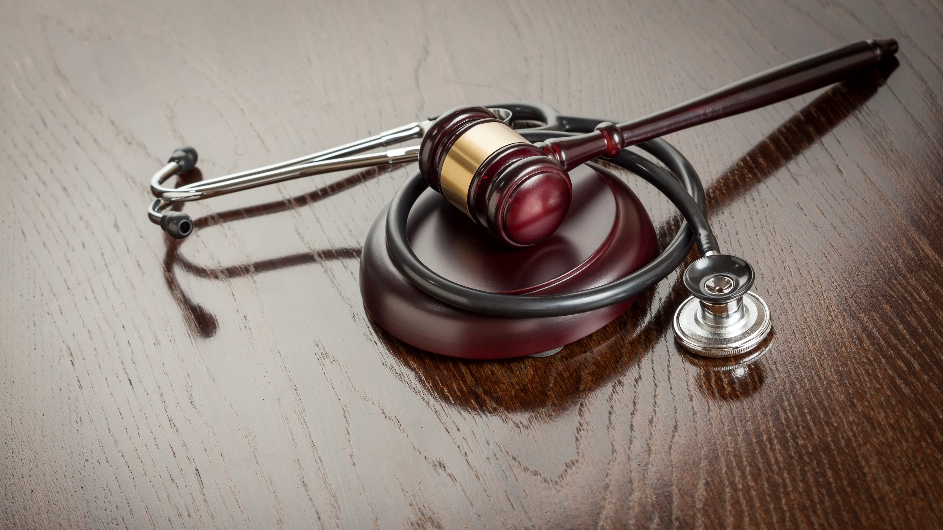 A courtroom gavel and a stethoscope