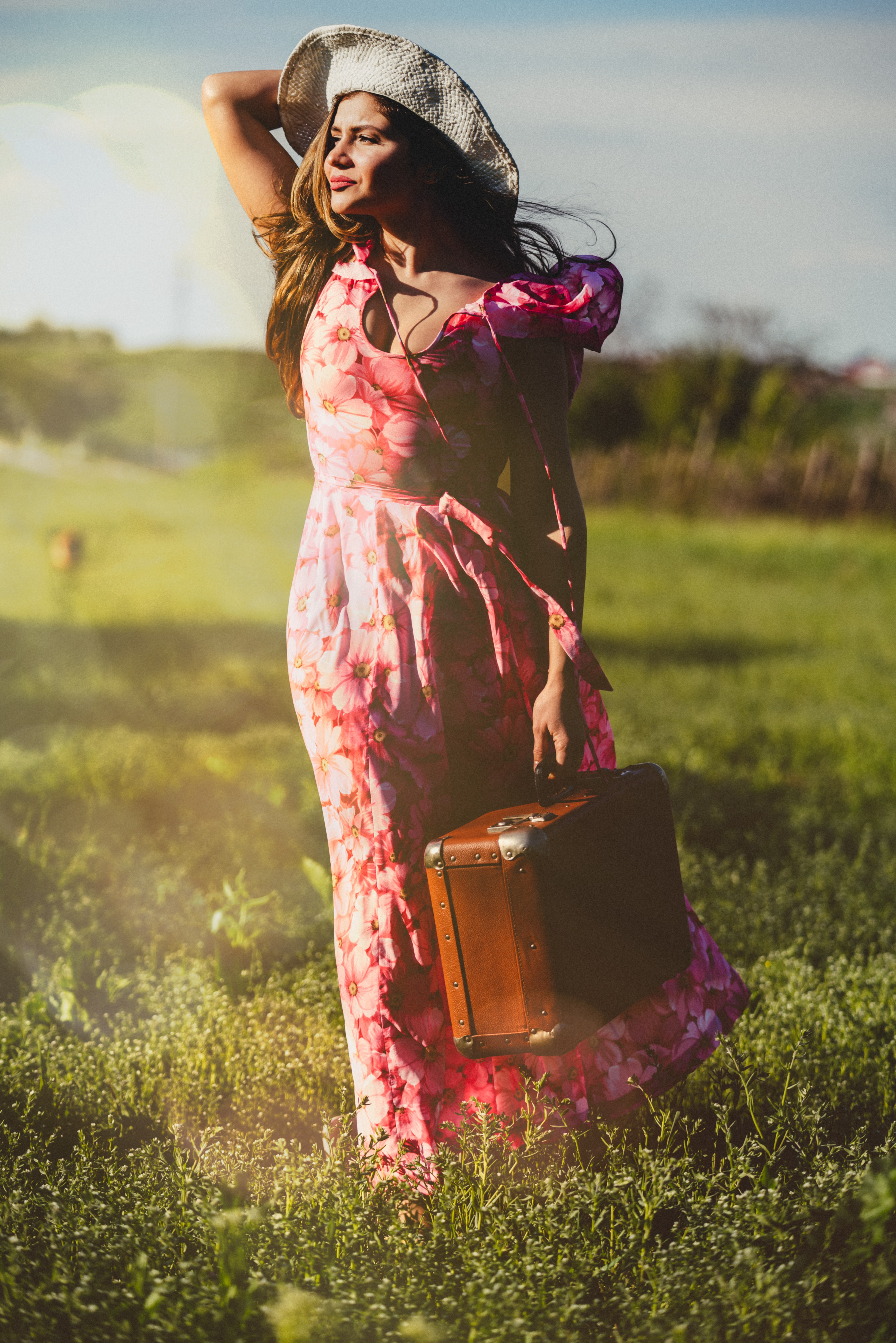 Travelling Hippy woman with suitcase by her side