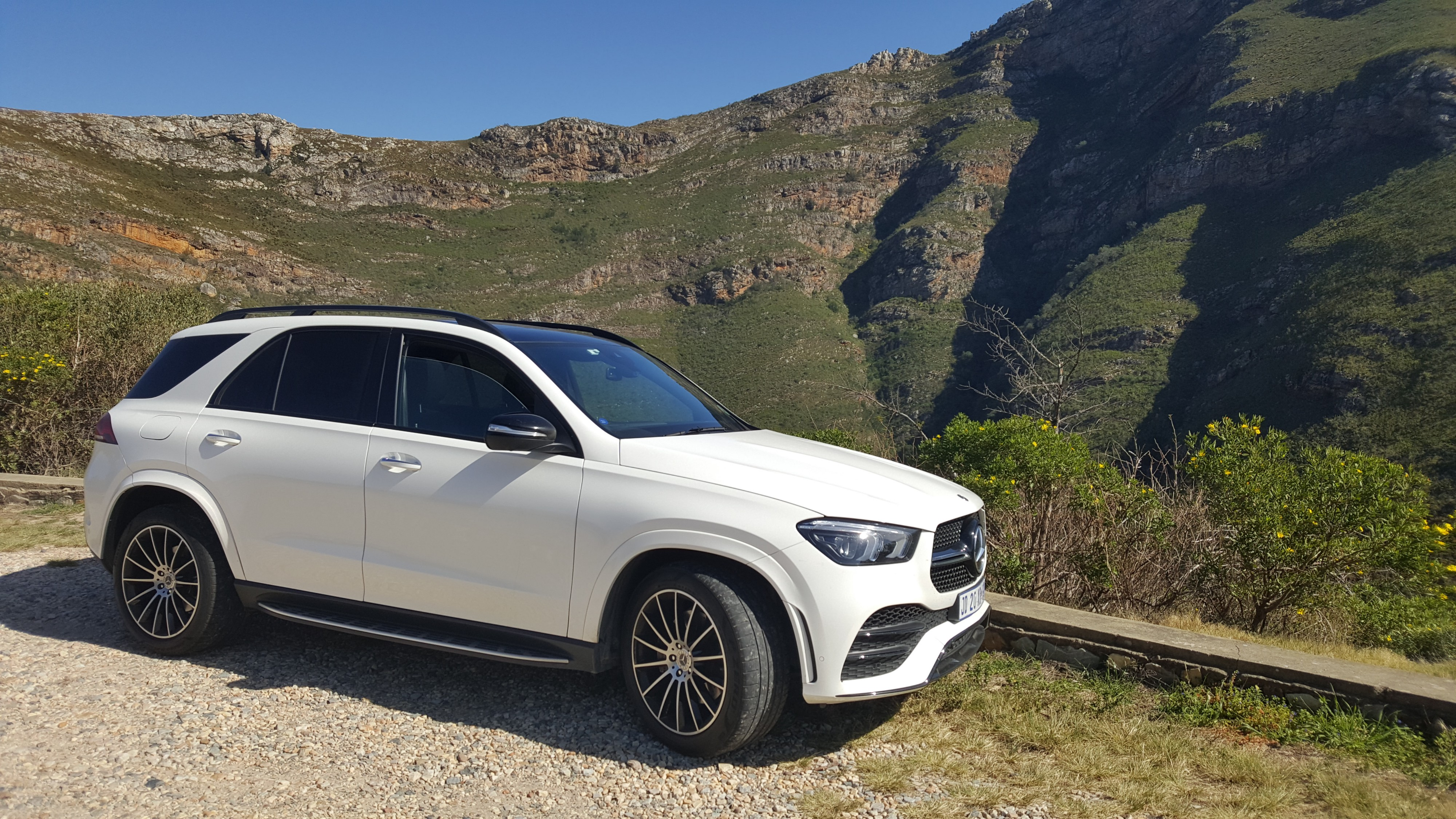 Mercedes-Benz GLE 400d against a mountain background