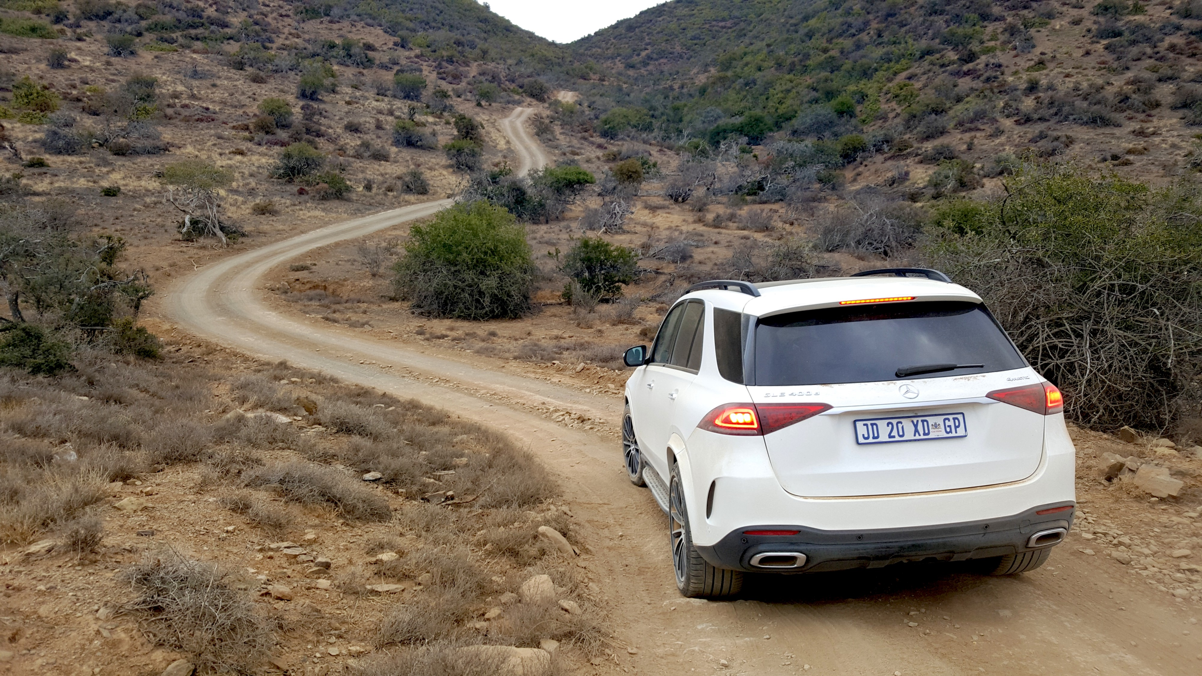 Mercedes-Benz GLE 400d being driven on a dirt road