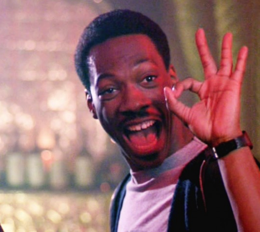 Eddie Murphy giving the OK symbol—From Beverly Hills Cop