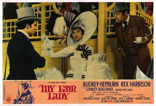 Poster of My Fair Lady in muted yellow and pink hues featuring, left to right, Jeremy Brett, Audrey Hepburn and Rex Harrison.