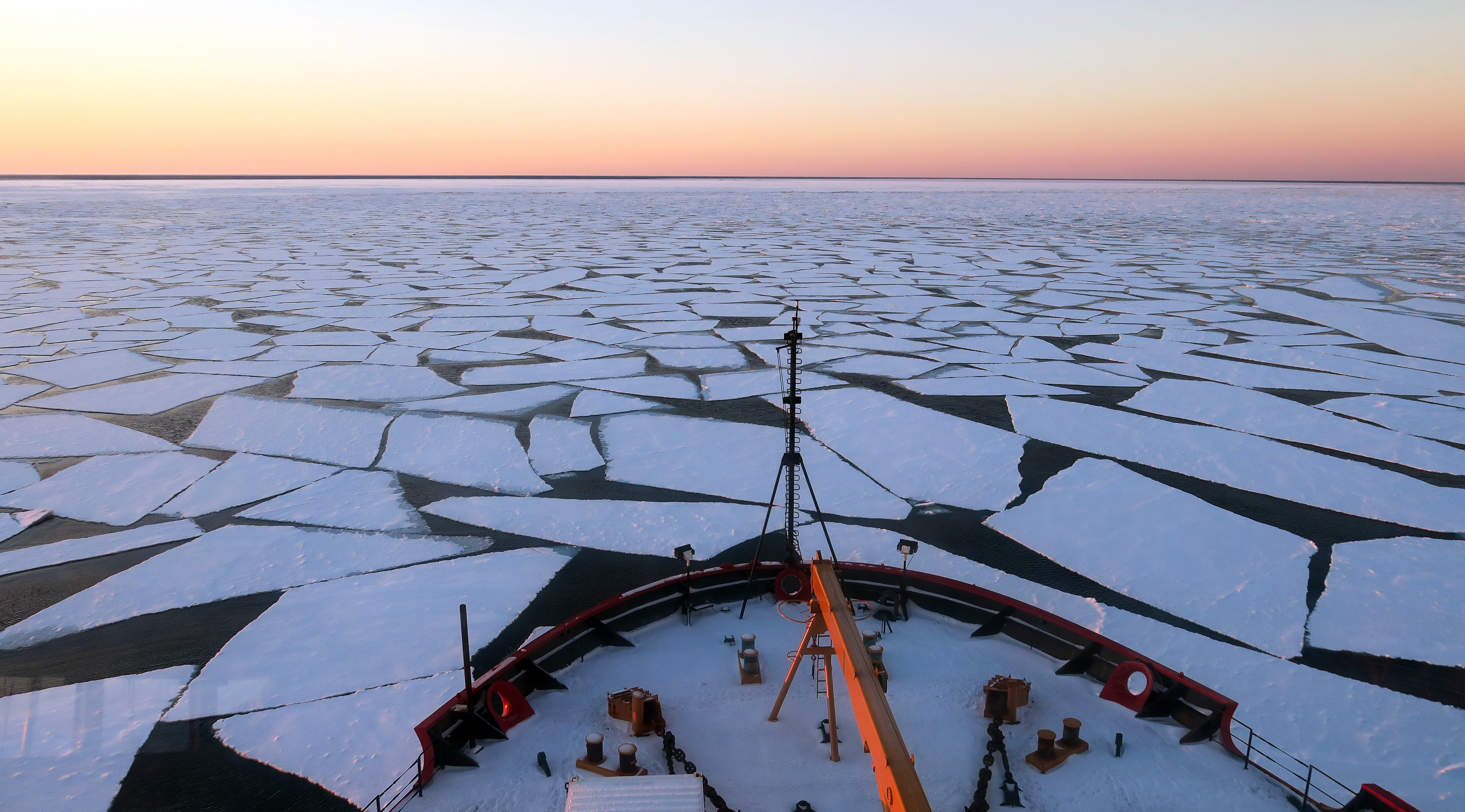 "Broken sea ice stretches out in front of U.S. Coast Guard icebreaker ""Healy"" as it cuts through the Beaufort Sea."