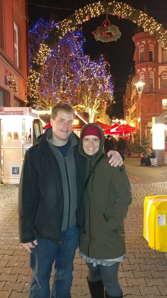 The happy couple in a Christmas market, hours before visiting the steam room.