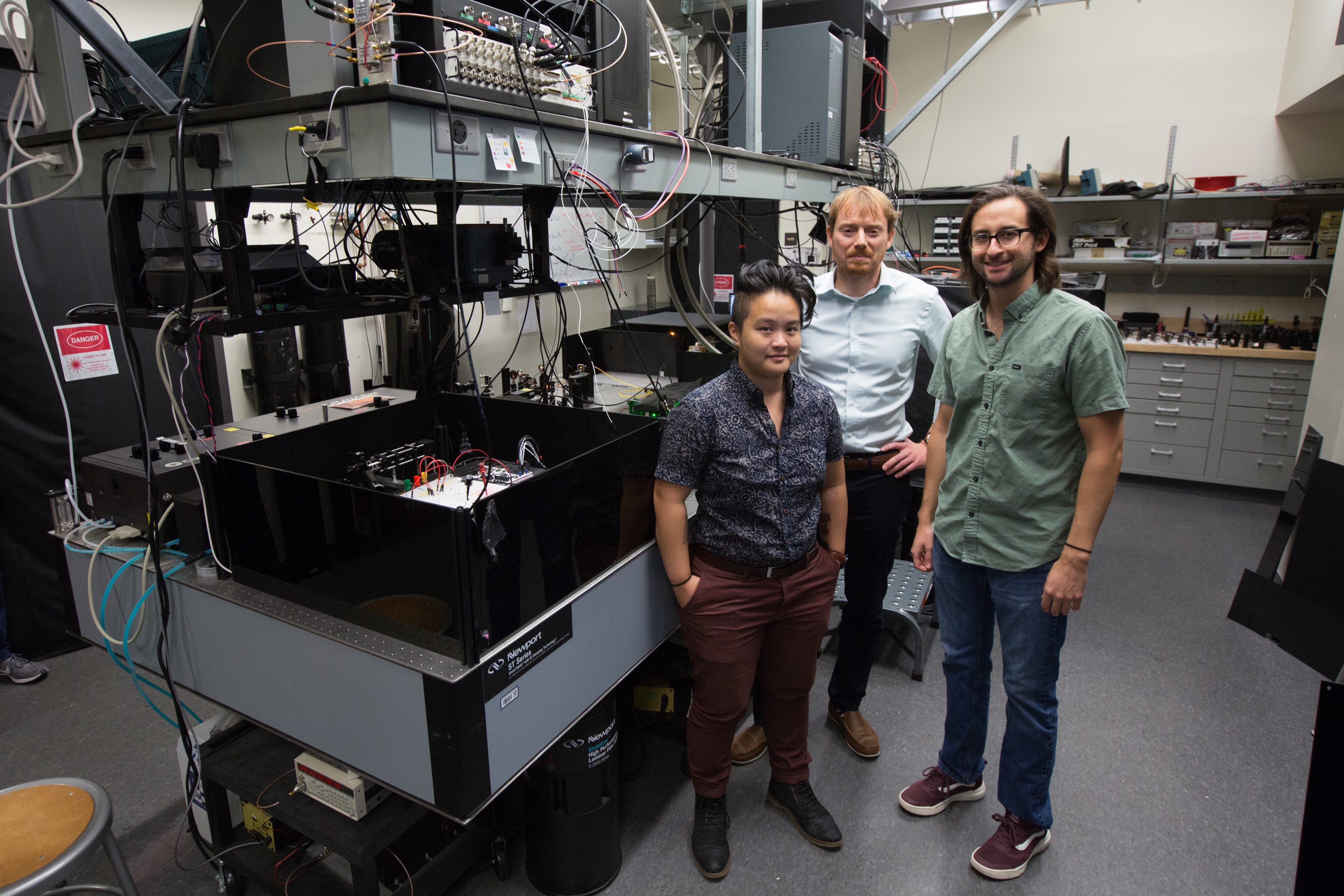 Huang, Bassett and Hopper in the Quantum Engineering Laboratory.