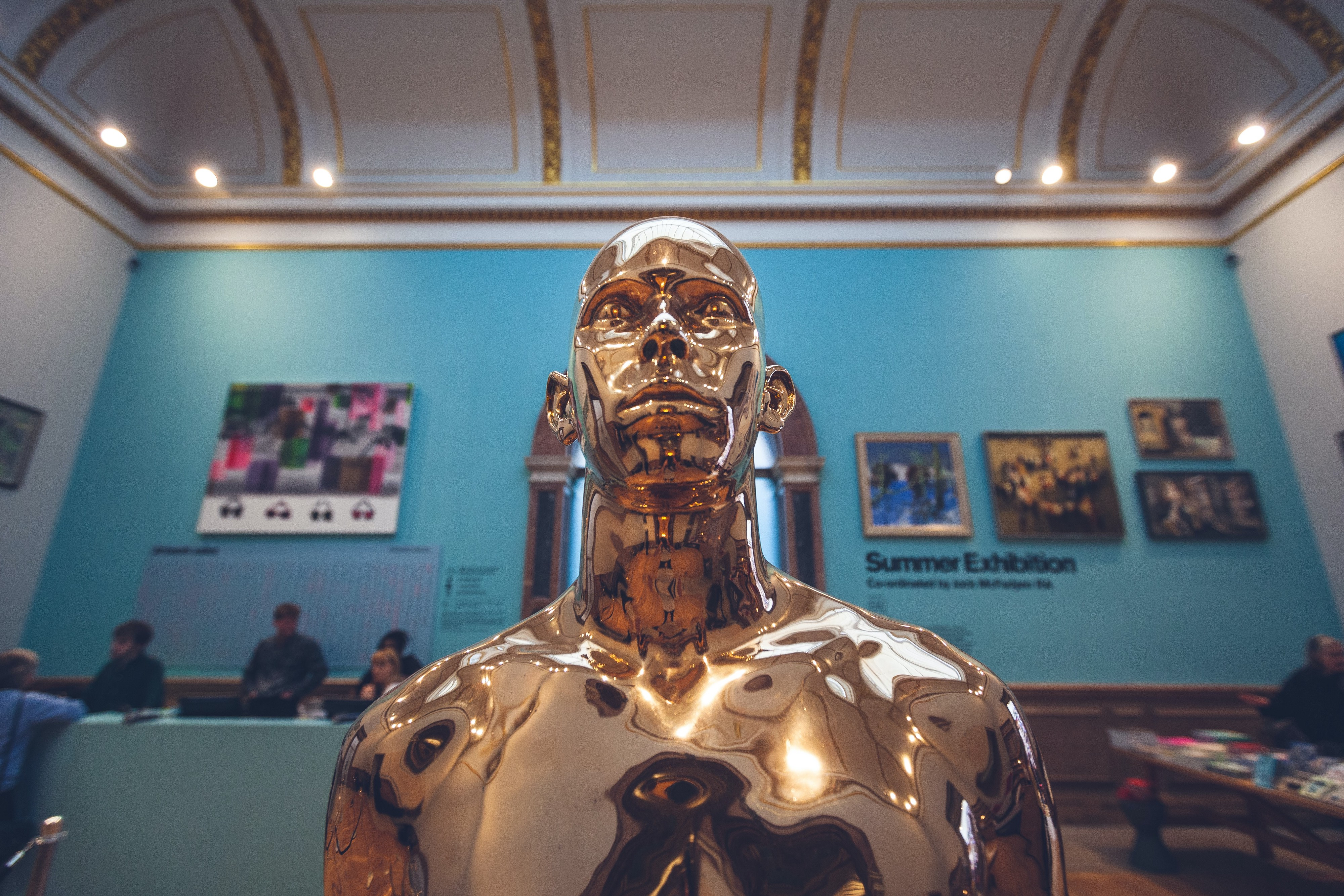 Golden statue of human in the museum exposition