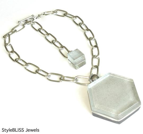 Silver chain necklace with glass hexagon pendant.
