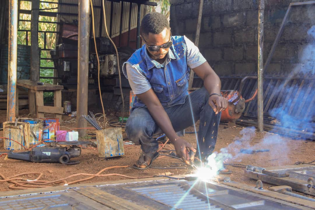 A welder doing his daily work with a diesel powered generator