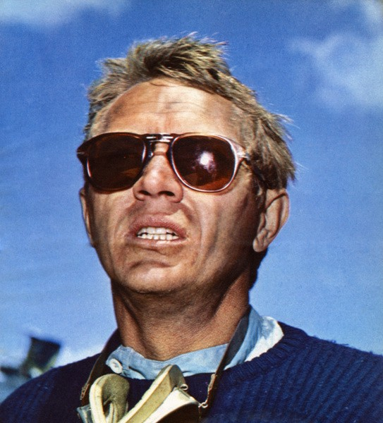 Here a navy blue crew-neck sweater-clad Steve McQueen participates in a racing event in Southern California in the mid-1960s