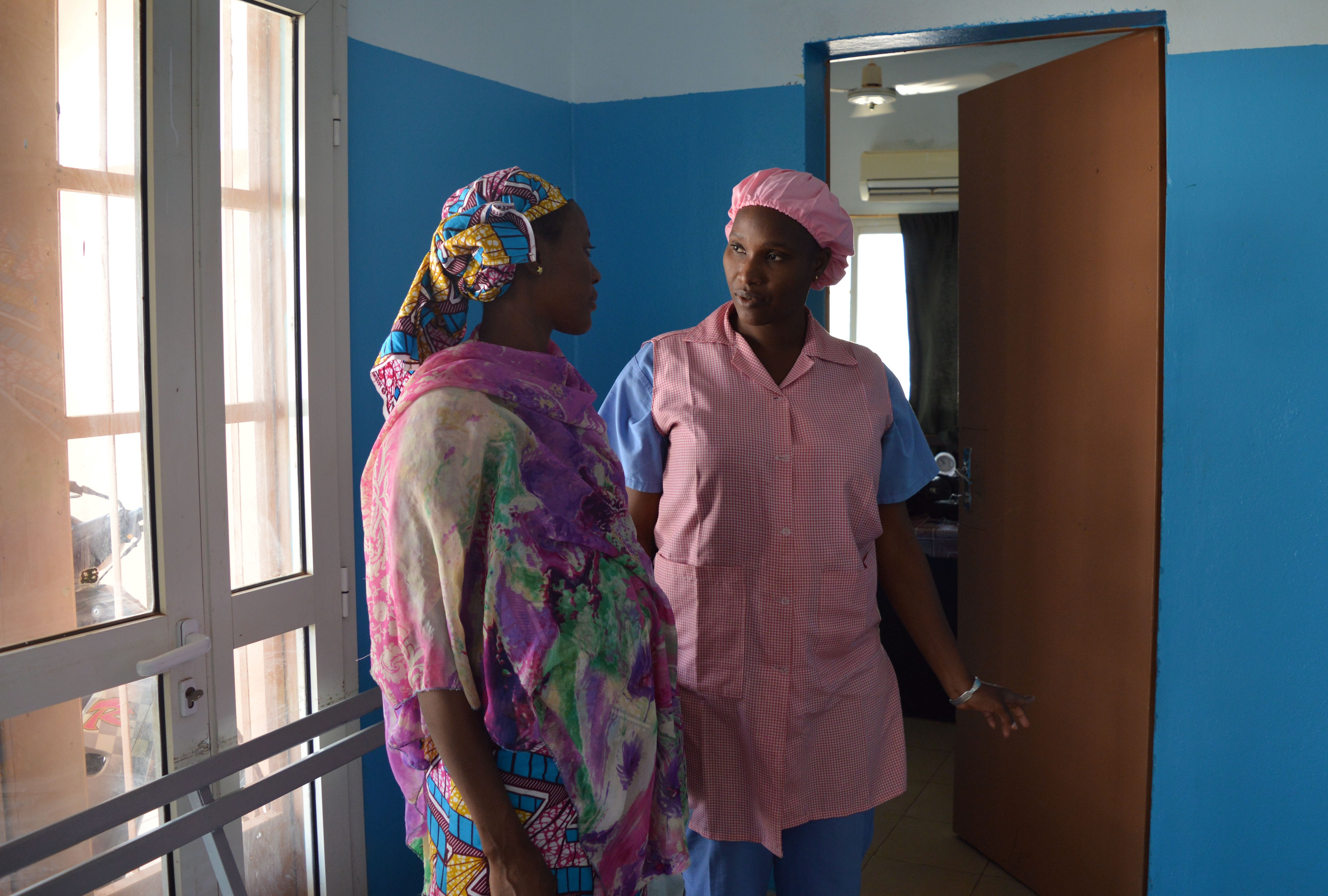 Mama Diancoumba (right) always takes time to reassure her patients and go over their concerns.