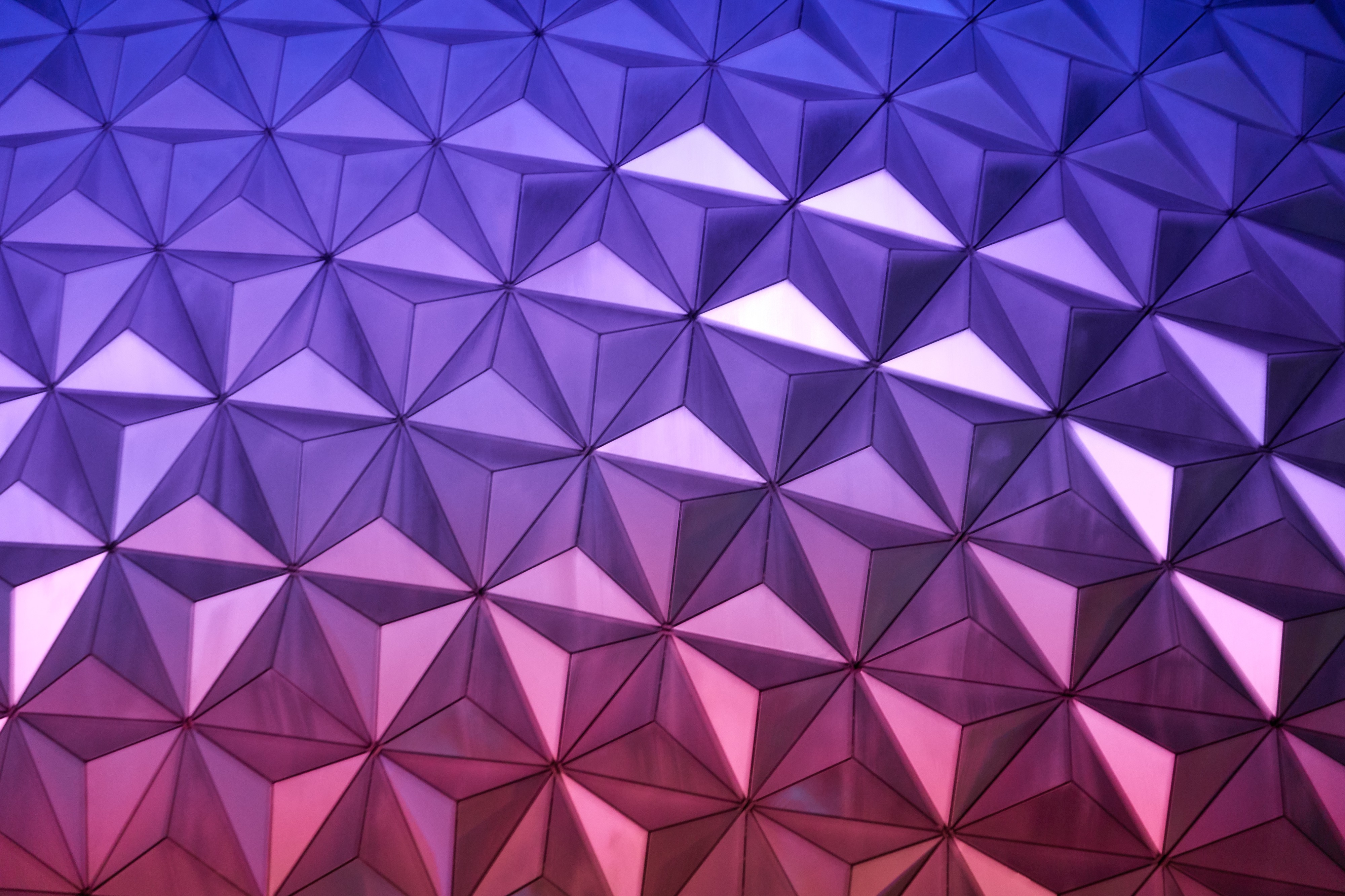 Photo by Robert Horvick of a triangular pattern of glass, purple and pink and reflective.