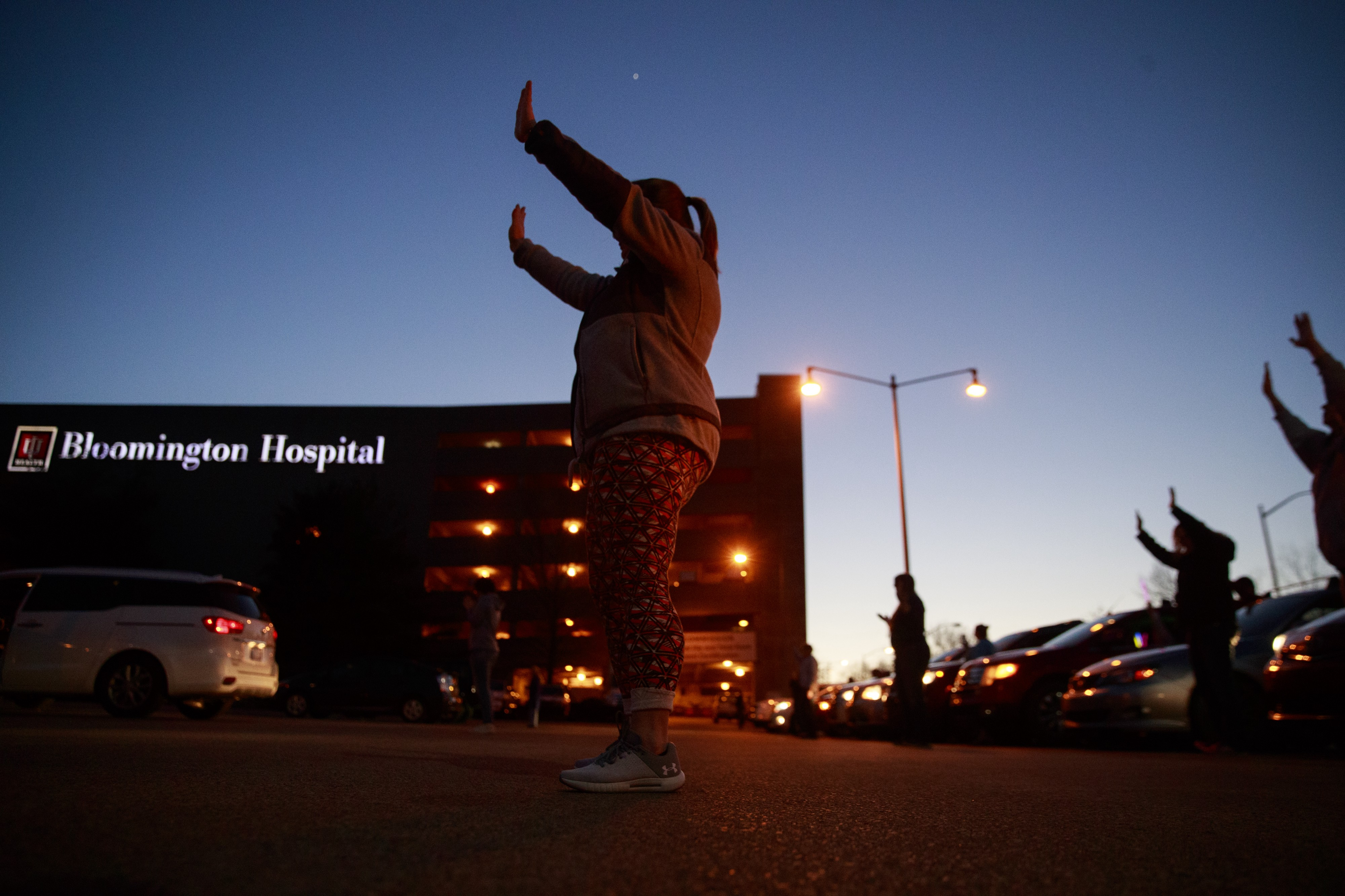 Members from the Lighthouse Fellowship Church gather on a Sunday night outside the Bloomington Hospital to pray for doctors,
